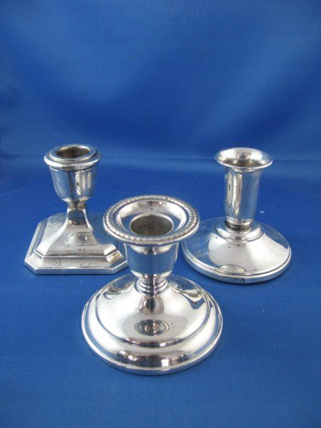 THREE  ASSORTED STERLING SILVER CANDLESTICKS