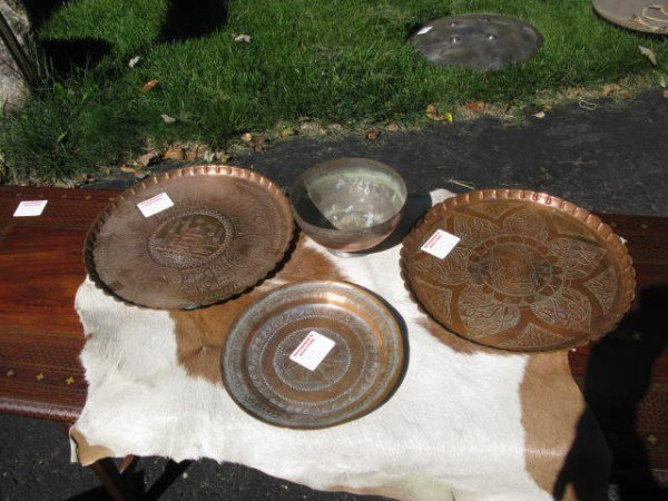 THREE COPPER TRAYS AND ONE BOWL