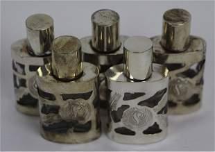 FIVE STERLING ENCASED OVAL FORM PERFUME BOTTLES