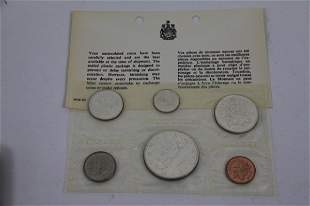 FOUR 1965 CANADIAN UNCIRCULATED COIN SETS