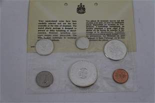 TWO 1964 CANADIAN UNCIRCULATED COIN SETS