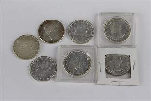 SEVEN CANADIAN SILVER DOLLARS 1967 AND EARLIER