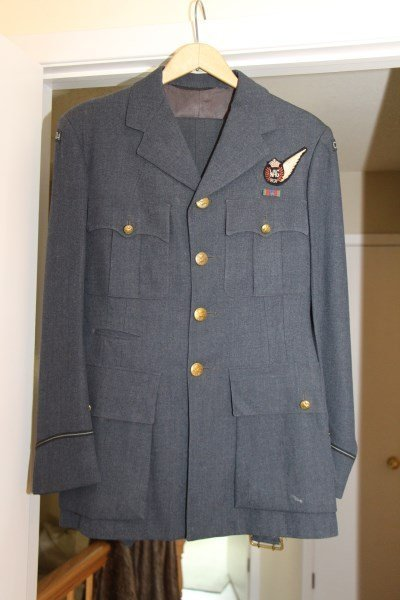 CIRCA 1945 R.C.A.F. TUNIC, HAND STITCHED RUG & HAT