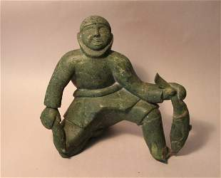 1950'S INUIT CARVING OF A FISHERMAN WITH CATCH