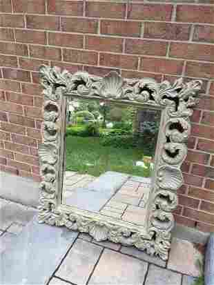 BEVELLED MIRROR IN DECORATED FRAME