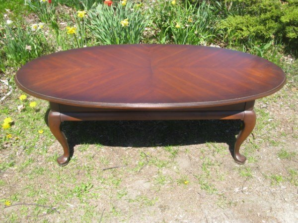 OVAL MAHOGANY STAIN COFFEE TABLE
