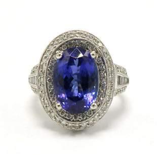 18Kt 6.54ct. Tanzanite & 1.00ct. Diamond Ring