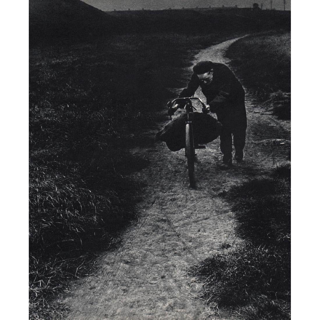 Bill Brandt - Coal-searcher going home to Jarrow