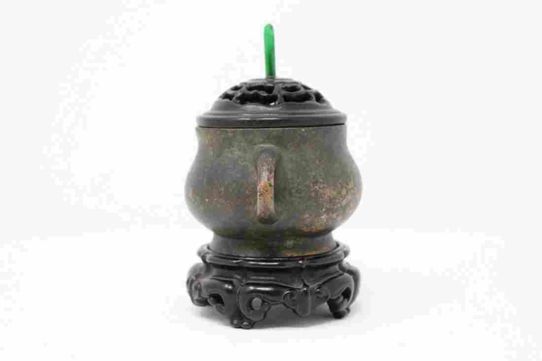 A CHINESE BRONZE CENSER AND WOOD COVER WITH STAND