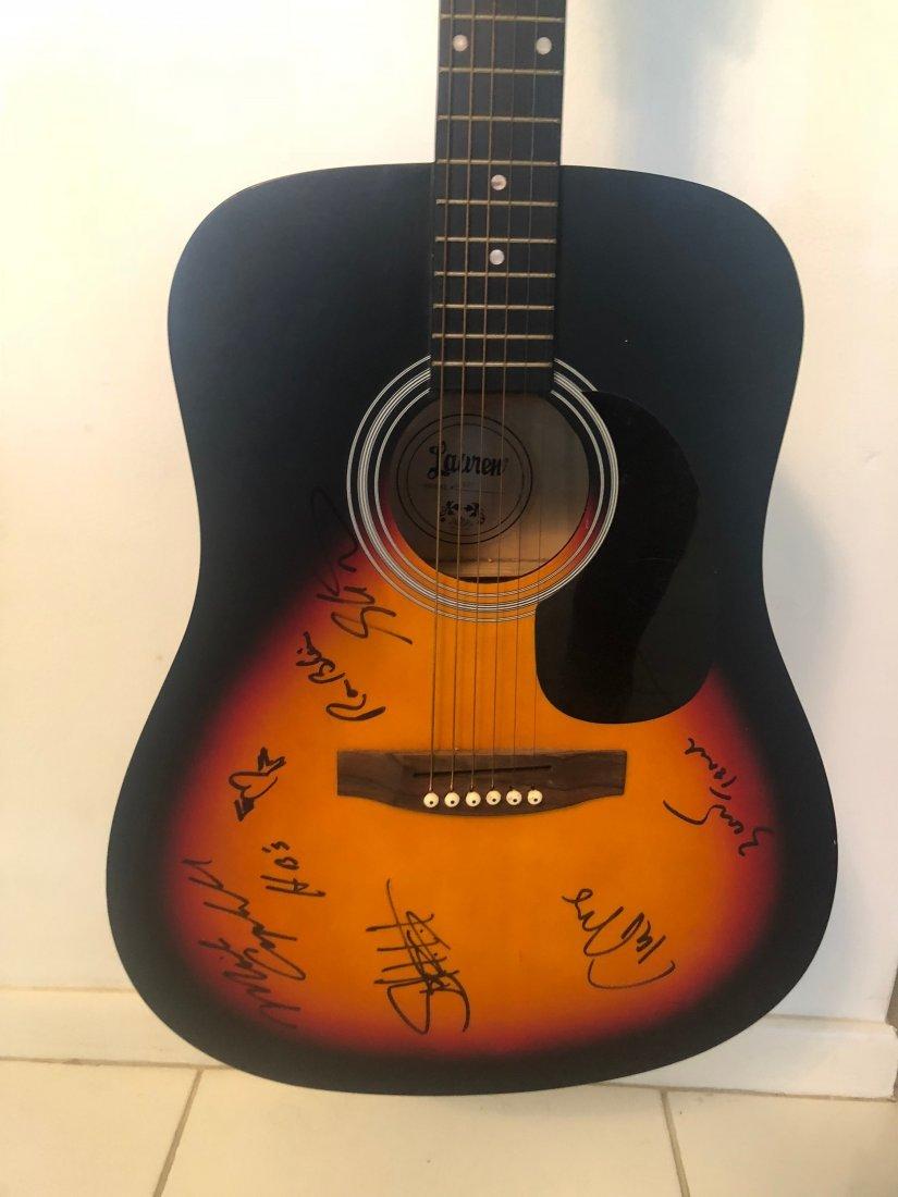 Signed Tom Petty & The Heartbreaker Guitar
