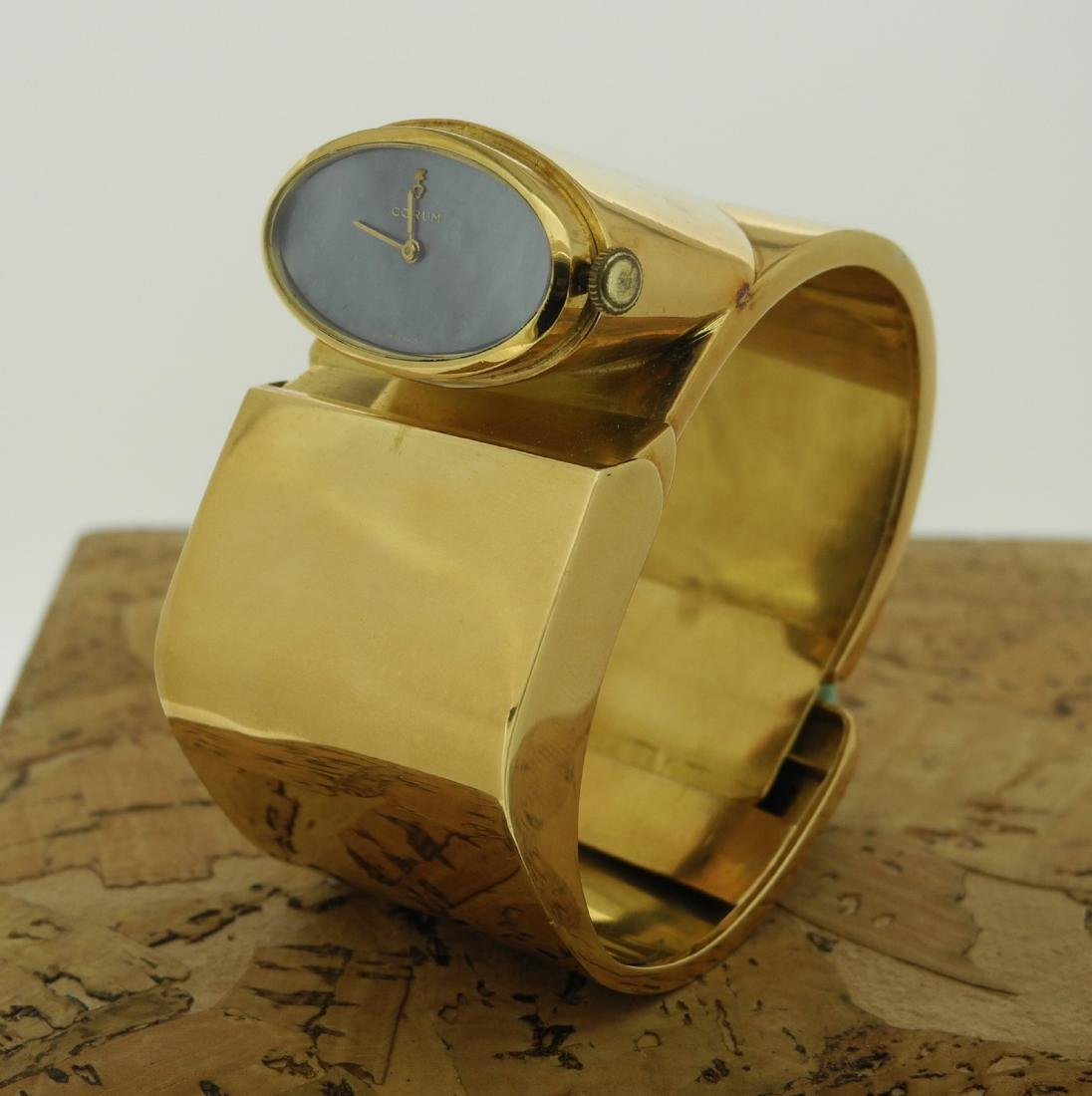 Corum Lady Cuff in Yellow Gold with Mother Pearl Dial