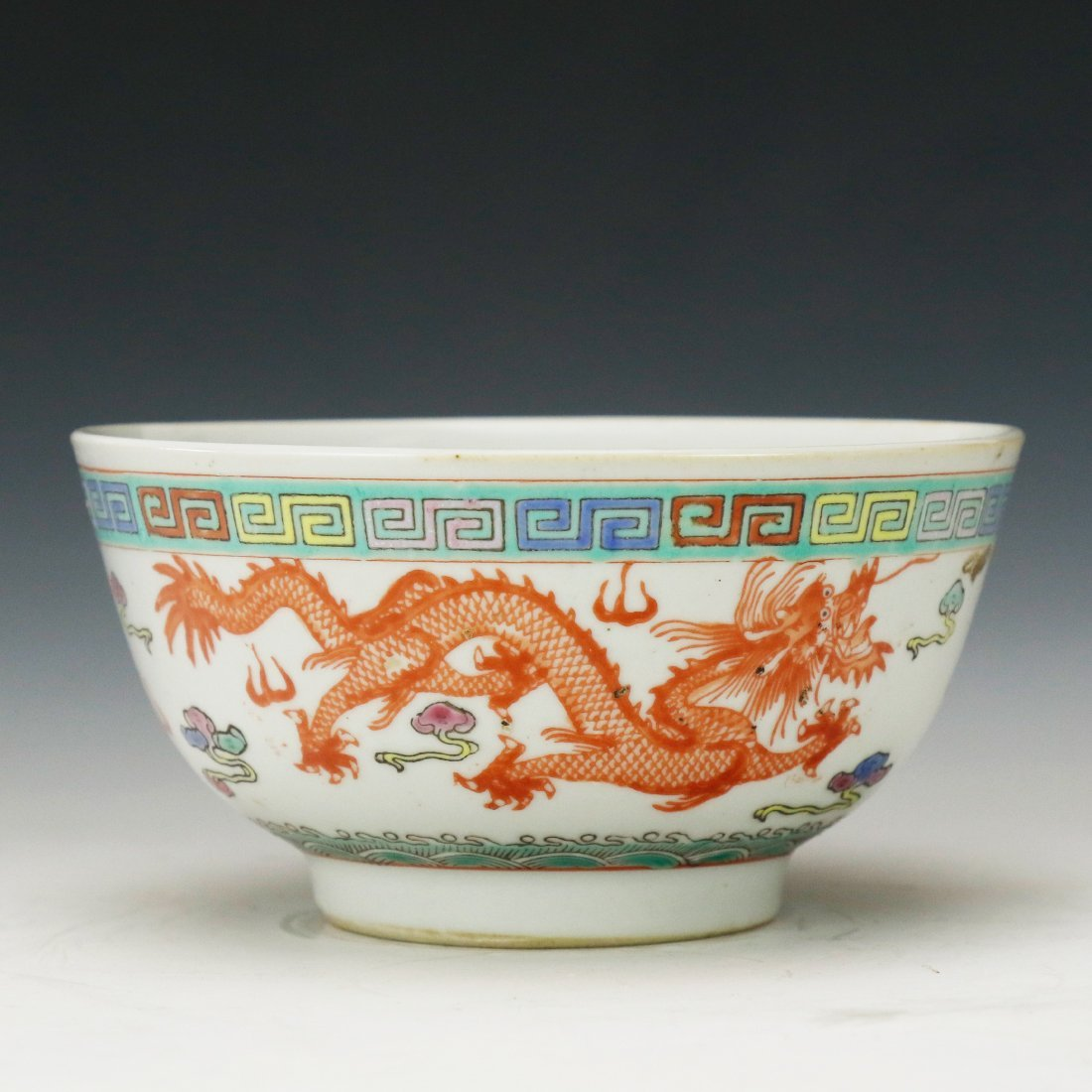 19 Century famille rose ceramic dragon bowl
