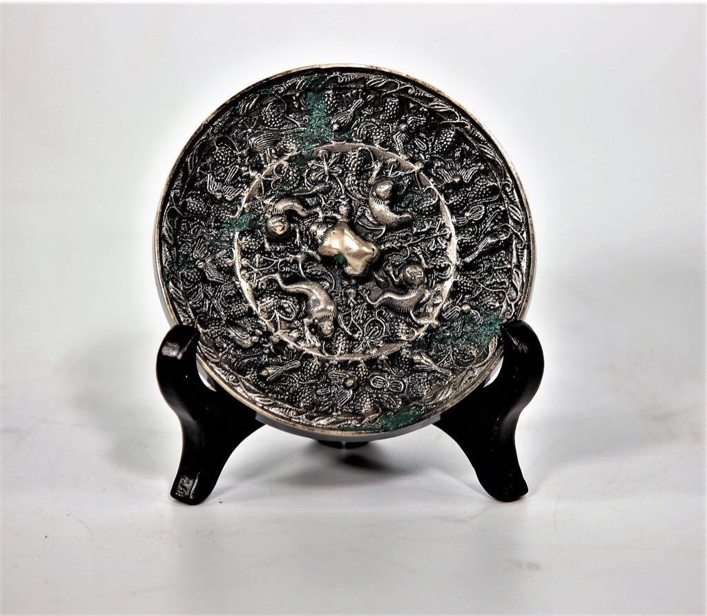 Chinese Tang Dynasty circular archaistic metal mirror