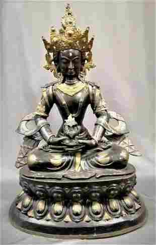 Tang Dynasty, A.D. 8th Century A Gilt Bronze Figure