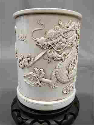 Qing  Wang Bingrong White Glaze Carved Dragon Porcelain