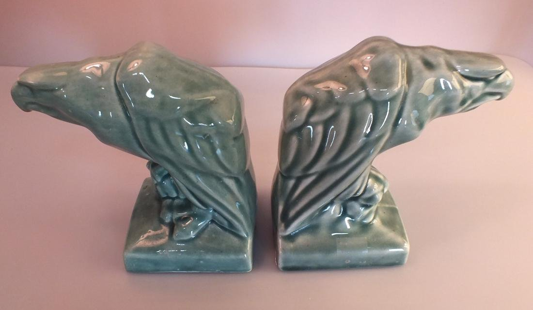 Green Pottery eagle statues pair c. 1950's