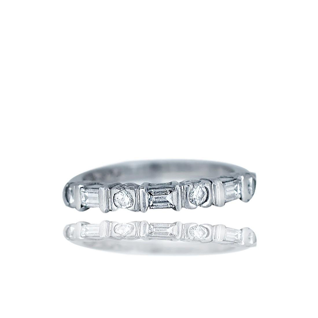 Engagement band with round and princess cut alternating