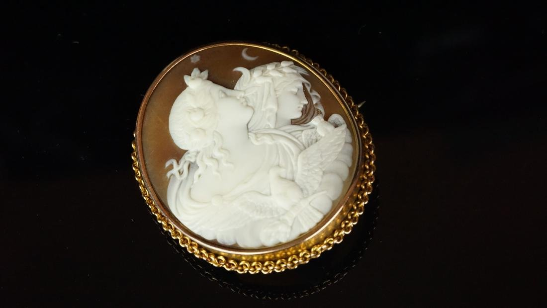 Cameo brooch, carved shell cameo of a male and female