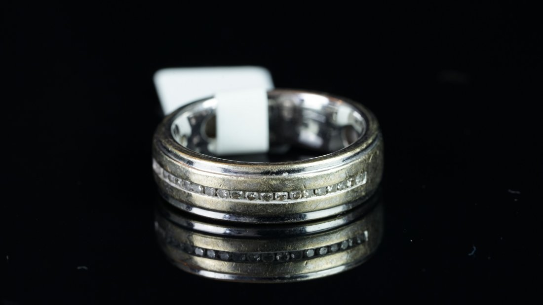 A diamond set band ring, channel set diamonds, mounted