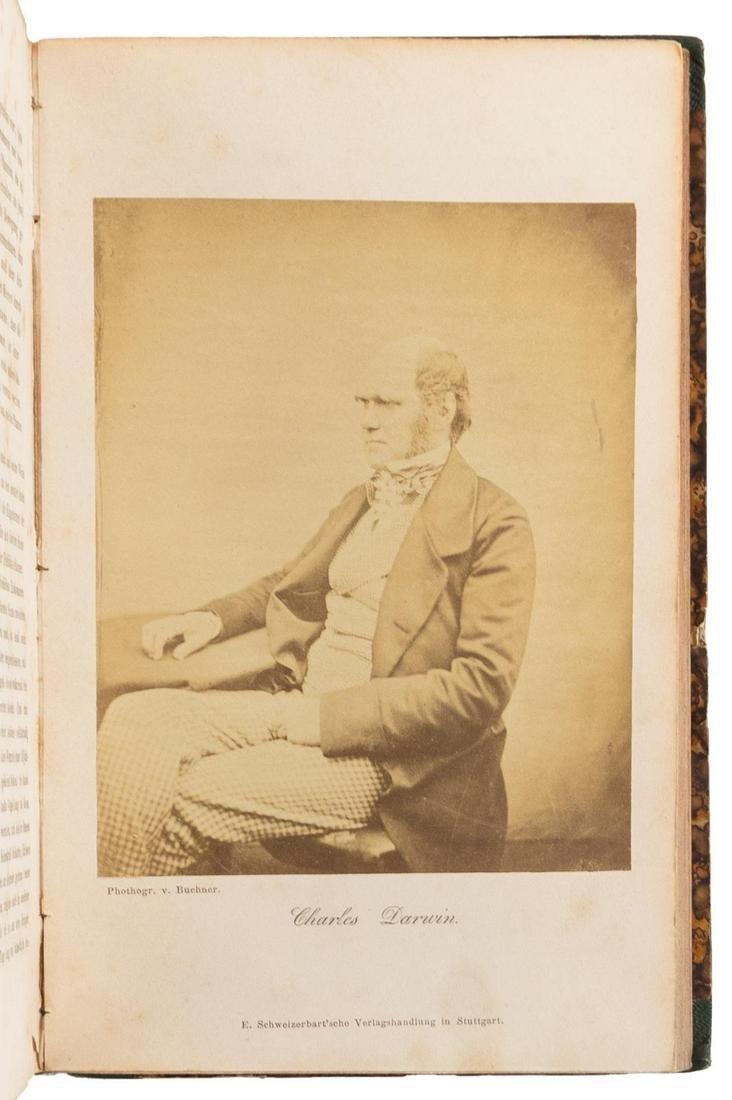With original portrait photograph of Darwin
