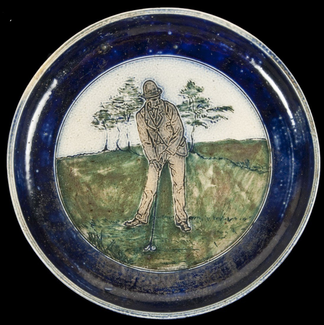 89: Stoneware plate with golfing scene by Martin