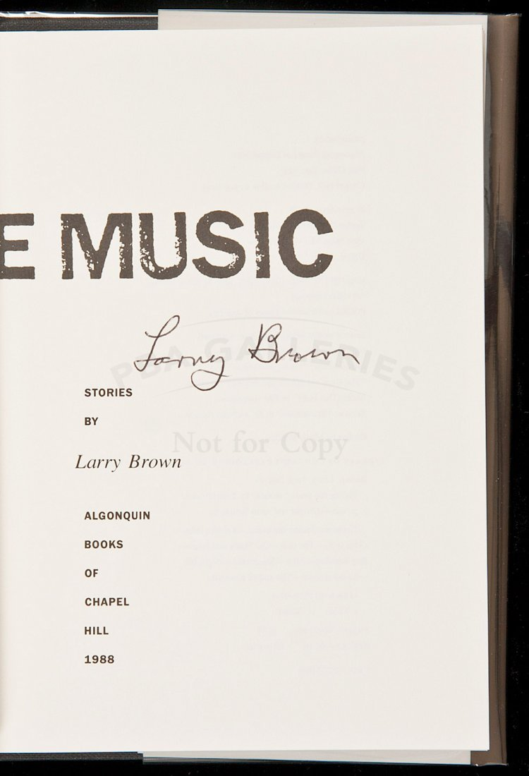 20: Larry Brown's 1st book Facing the Music signed