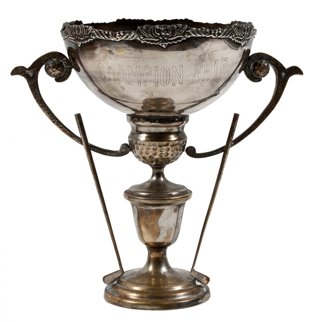 """Silver golf trophy with the word """"Championship"""""""