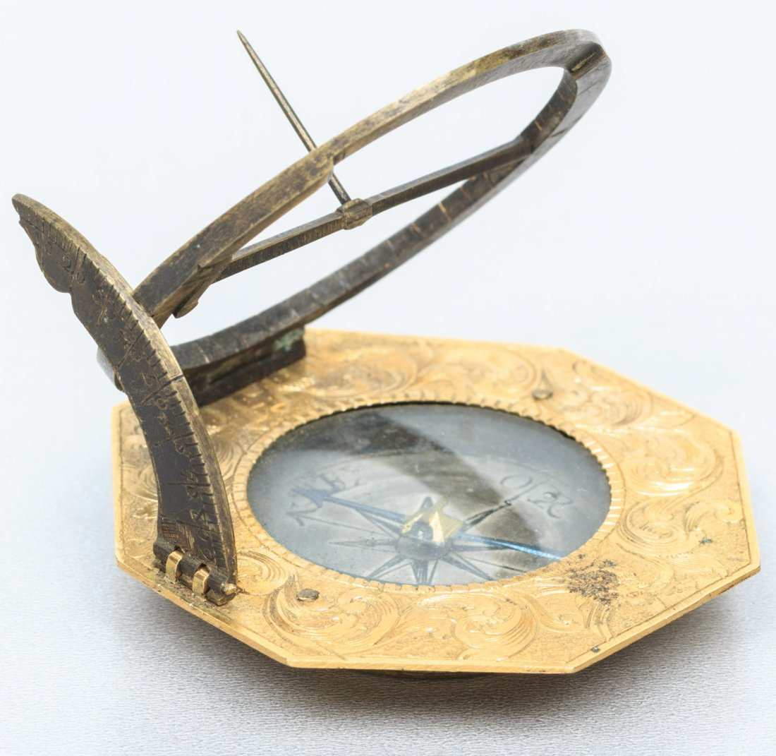 Two sundials, a French brass butterfly and a German