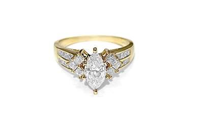14K Yellow gold. 0.80CT Marquise Cut Diamond Ring