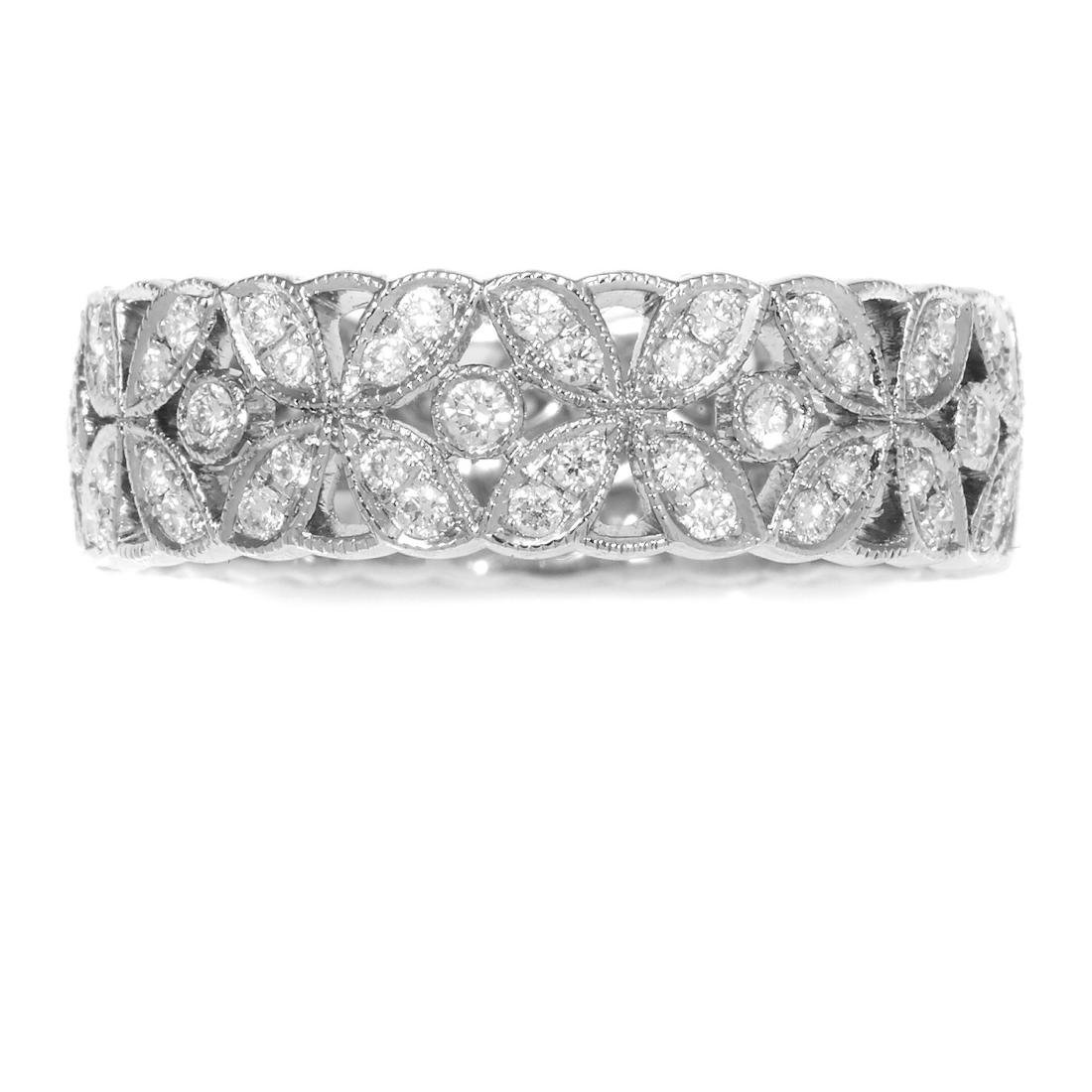 A DIAMOND BAND RING in platinum, the band decorated