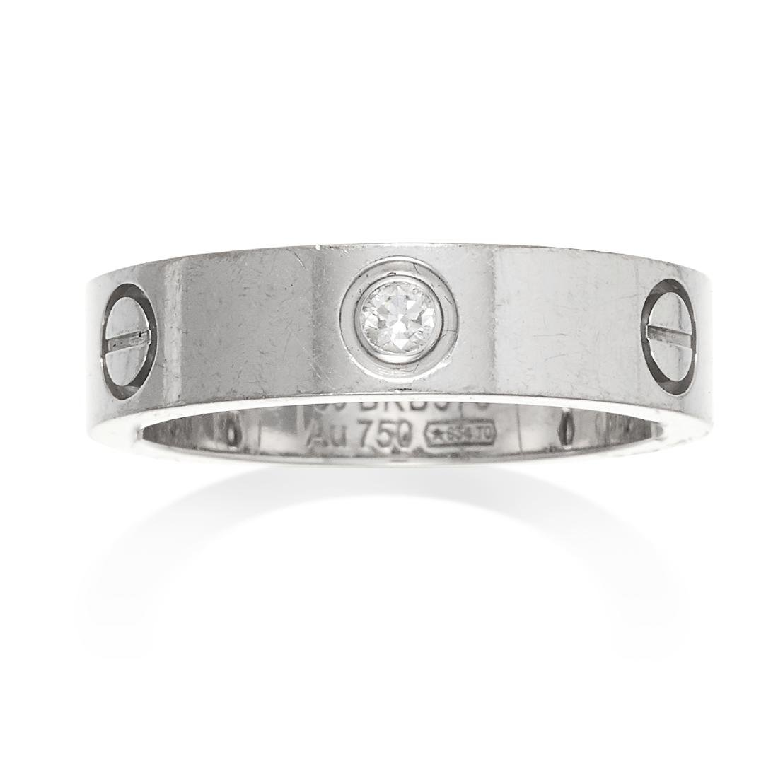 A DIAMOND LOVE RING, CARTIER in 18ct white gold,