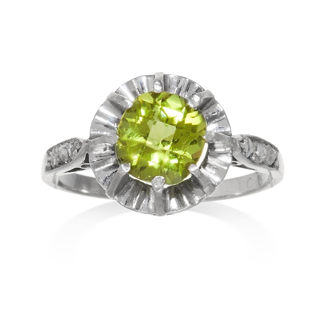 AN ART DECO PERIDOT AND DIAMOND RING in gold or