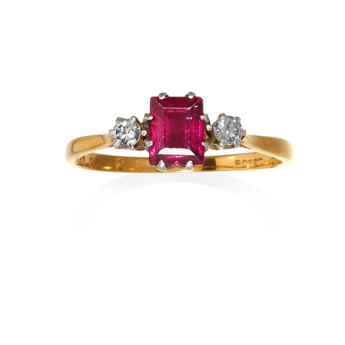 A RUBY AND DIAMOND THREE STONE RING in 18ct yellow gold