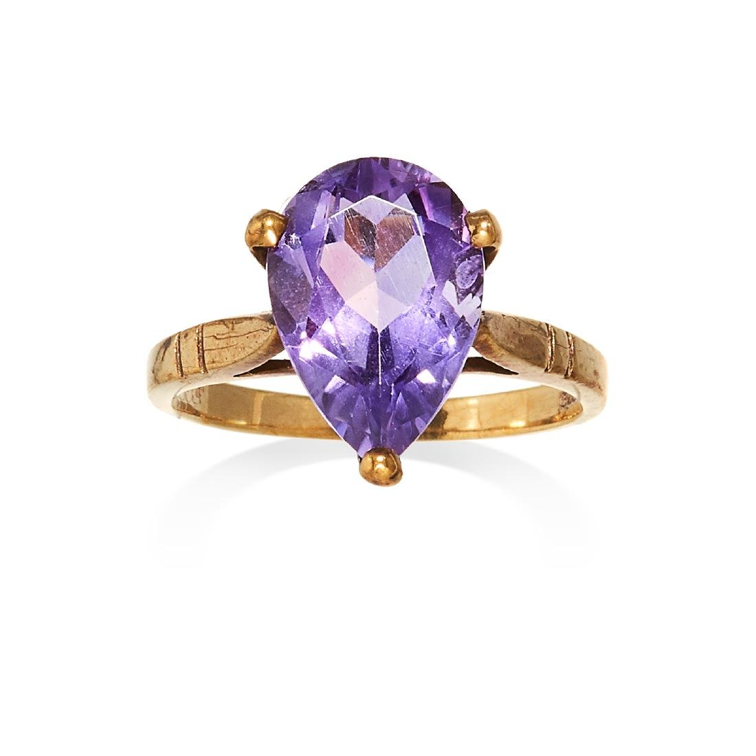 AN AMETHYST DRESS RING in yellow gold, set with a pear