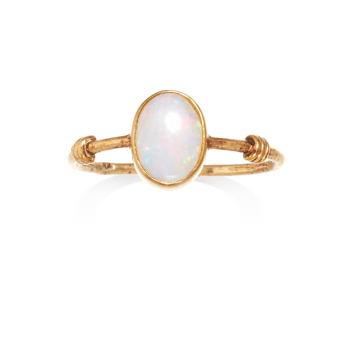 AN OPAL DRESS RING in yellow gold, the oval cabochon