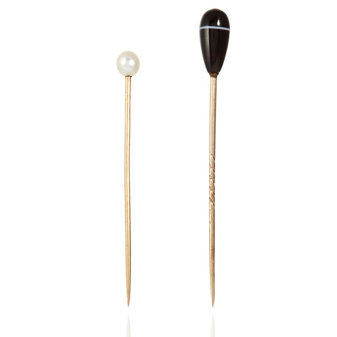 TWO ANTIQUE TIE / STICK PINS in yellow gold, one set
