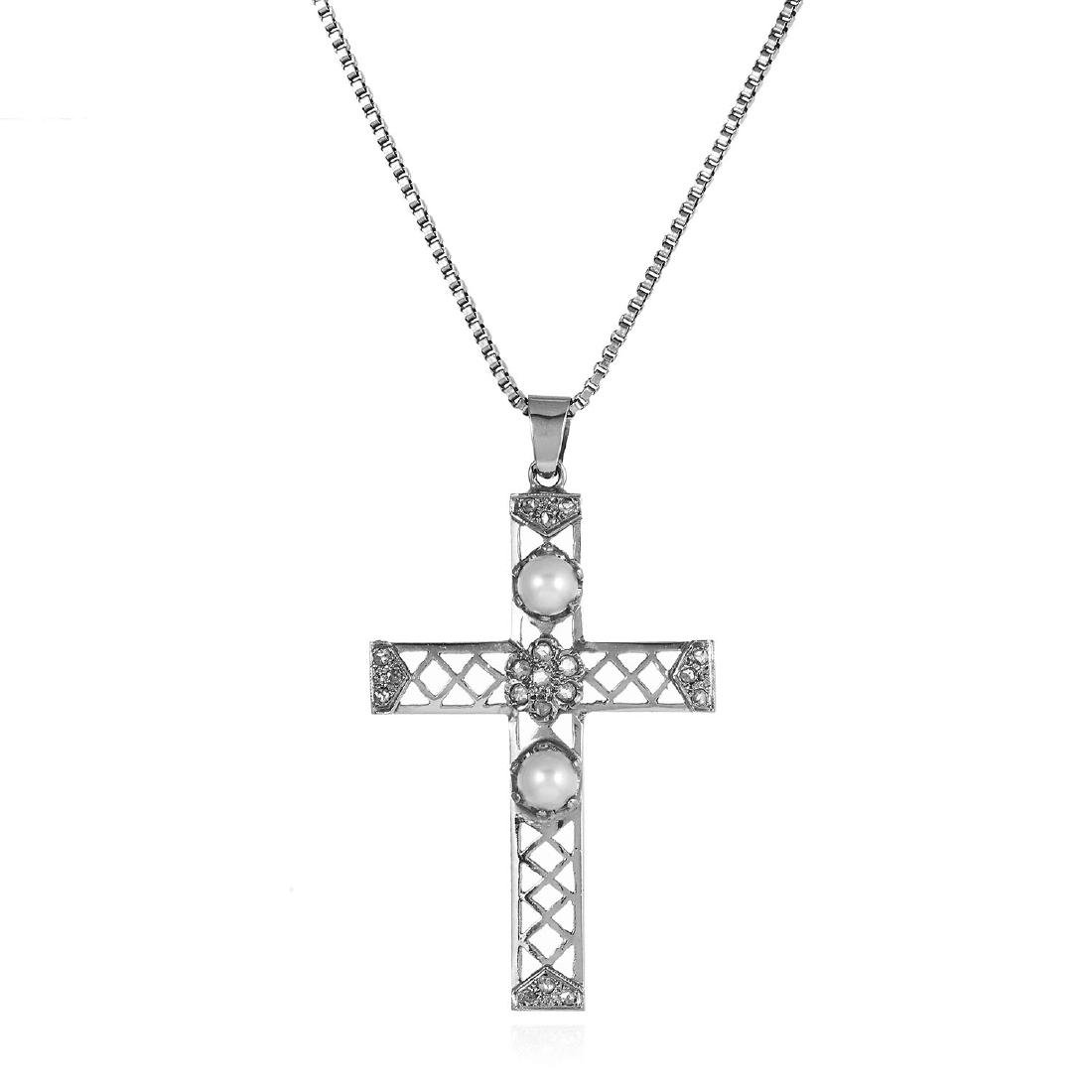 A DIAMOND AND PEARL CROSS PENDANT in white gold or