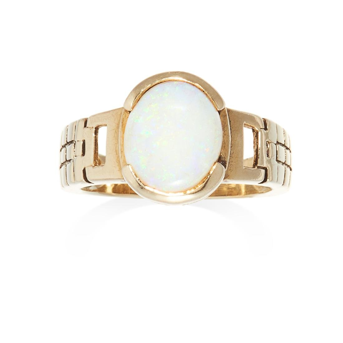 AN OPAL DRESS RING in 9ct yellow gold, set with an oval