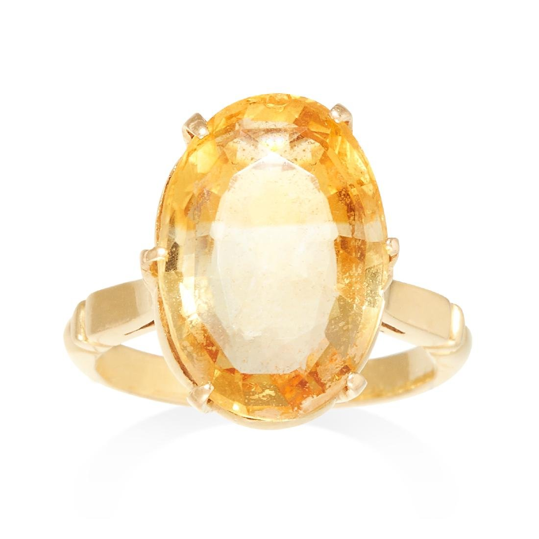 A CITRINE DRESS RING in yellow gold, set with a large
