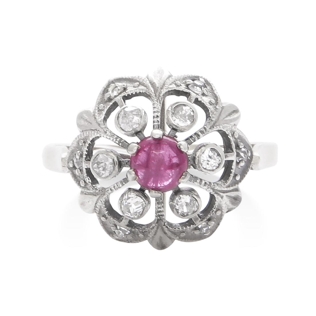 A RUBY AND DIAMOND DRESS RING in yellow gold and