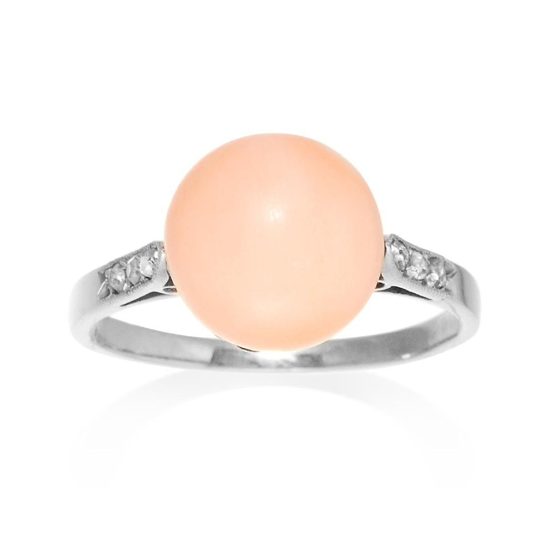 A CORAL AND DIAMOND DRESS RING in gold or platinum, set