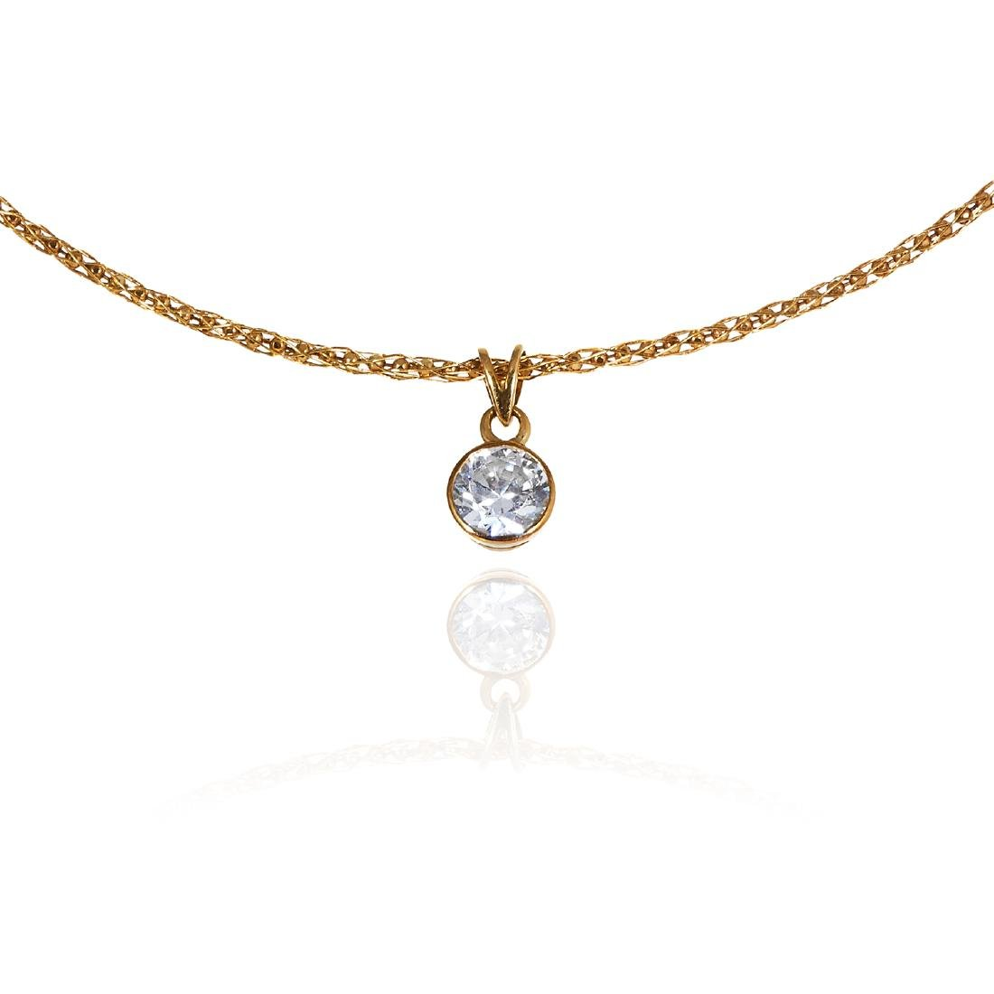 A CRYSTAL GOLD CHAIN TORQUE in 18ct yellow gold,