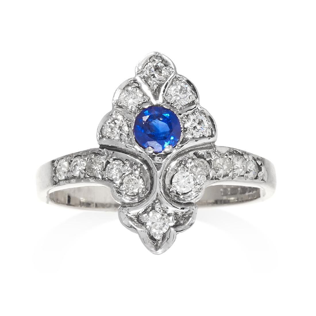 A SAPPHIRE AND DIAMOND DRESS RING in yellow and white