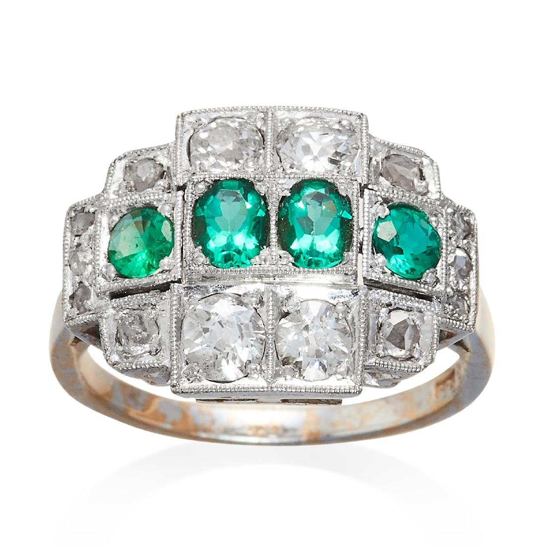 AN ANTIQUE EMERALD AND DIAMOND RING in white gold, four