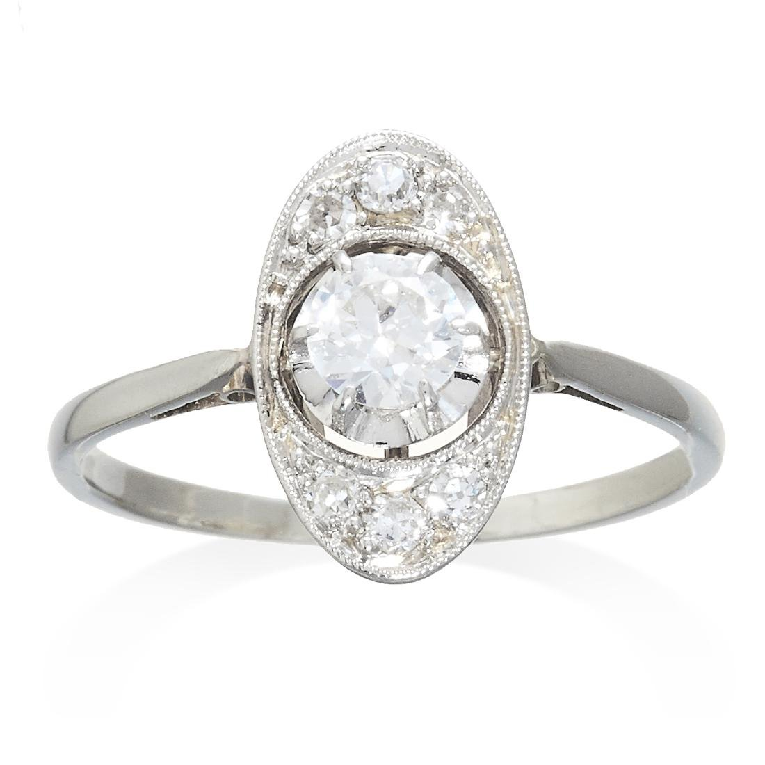 A DIAMOND DRESS RING in white gold or platinum, the