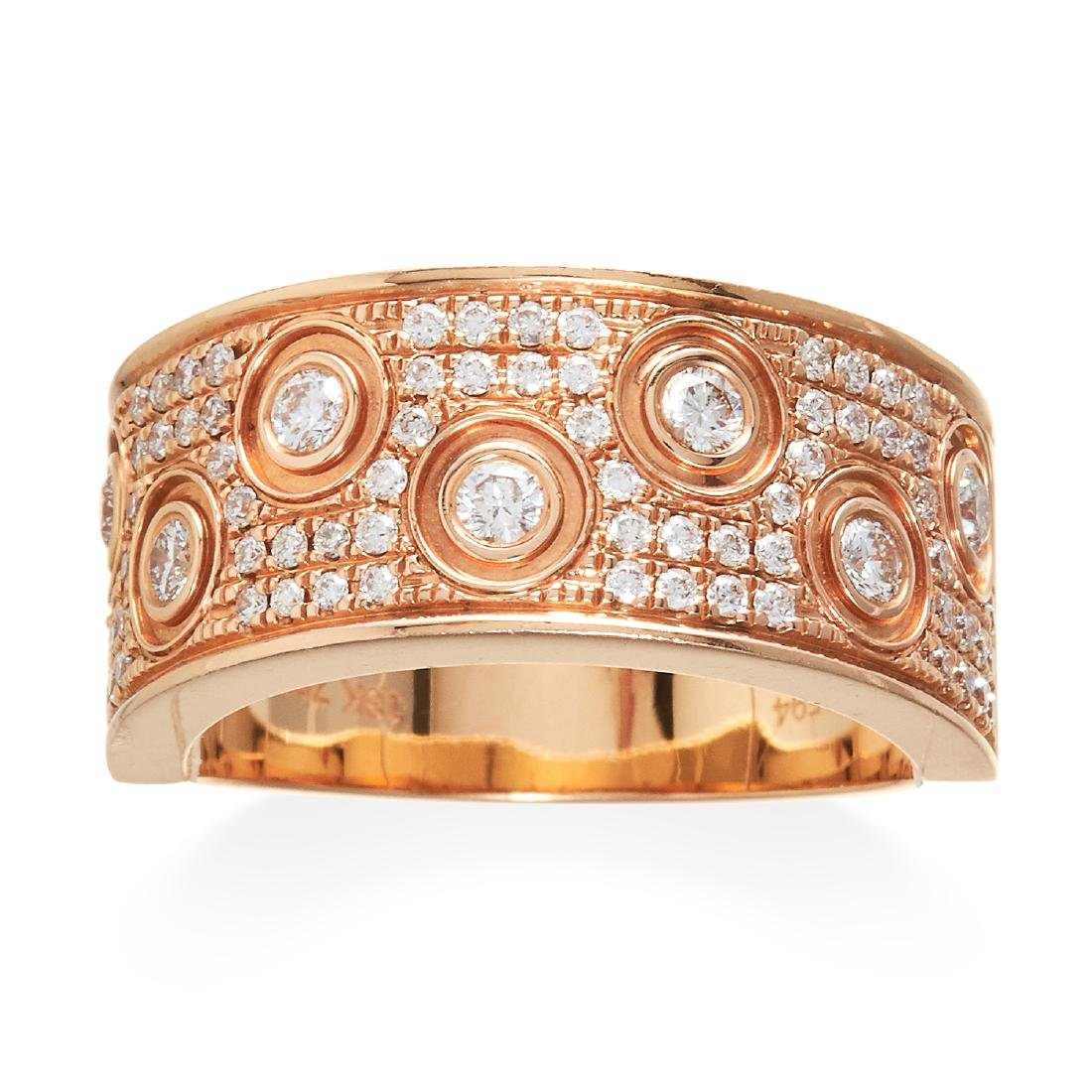 A DIAMOND DRESS RING in 18ct rose gold, jewelled with