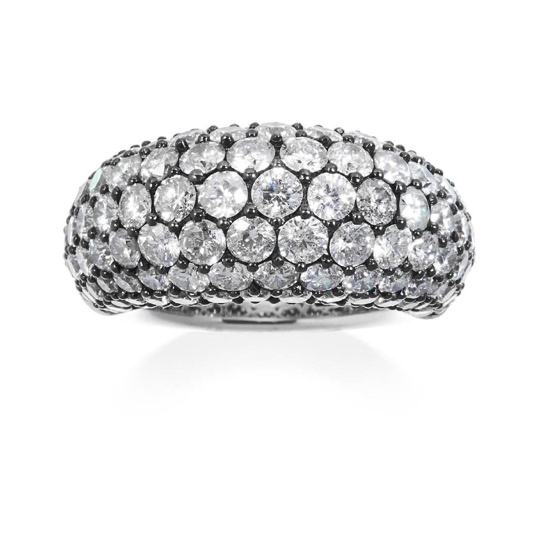 A DIAMOND DRESS RING in 18ct white gold, jewelled with