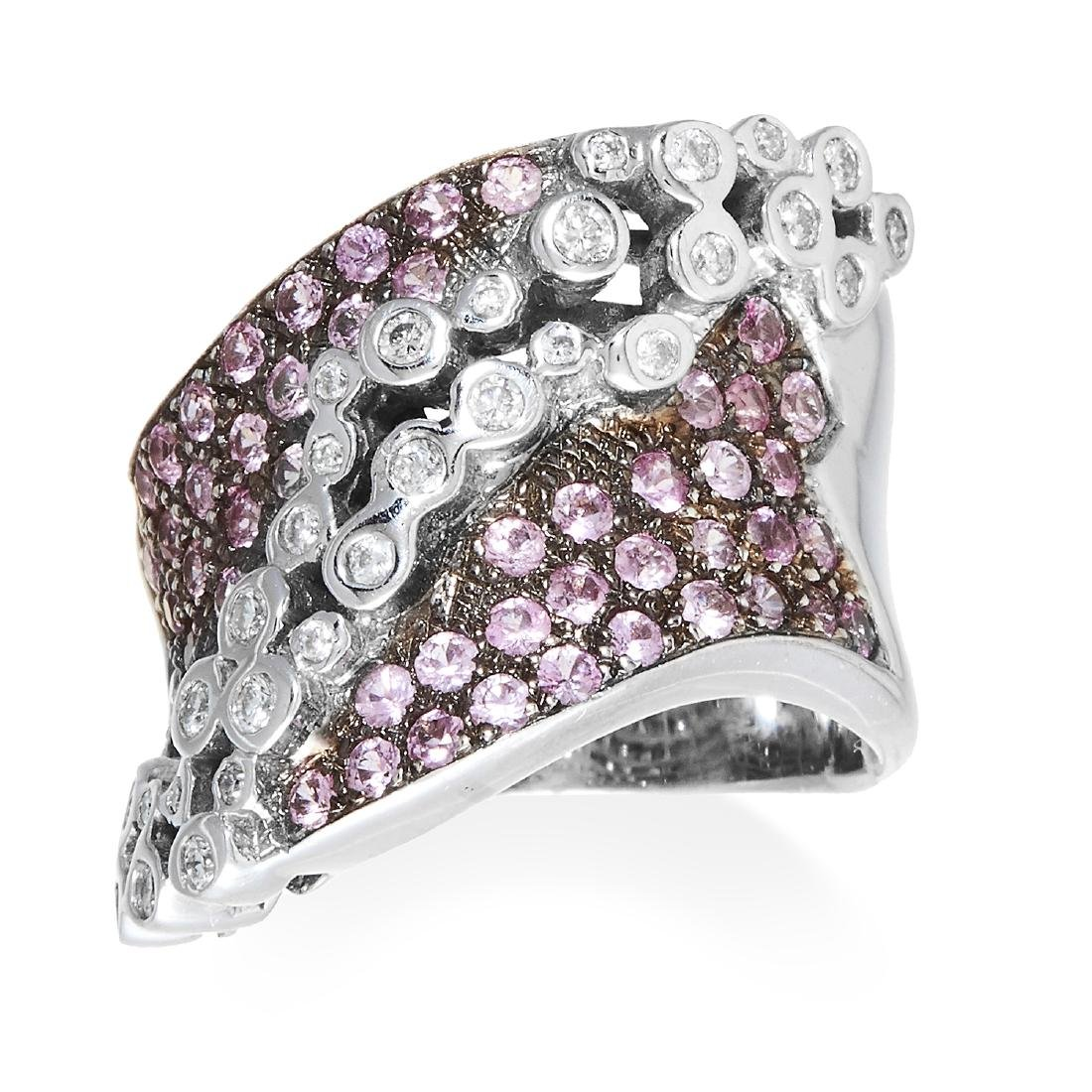 A TOPAZ AND DIAMOND DRESS RING in 18ct white gold,