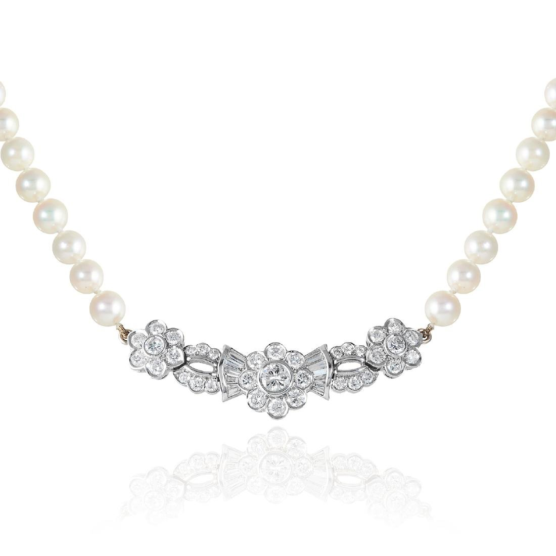 A PEARL AND DIAMOND NECKLACE in 18ct white gold,