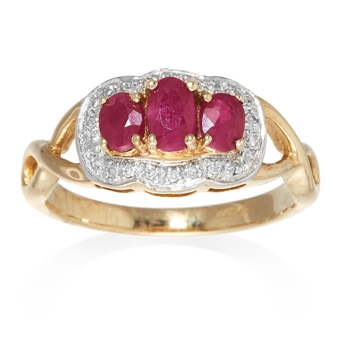 A RUBY AND DIAMOND DRESS RING in 9ct yellow gold, set